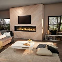 A fireplace can be defined as an architectural structure which is designed to hold a fire. In recent decades, fireplaces are usually used for the purpose of relaxation and ambiance. Fireplace Tv Wall, Linear Fireplace, Basement Fireplace, Fireplace Design, Fireplace Ideas, Picture Frame Decor, Living Room Tv, Great Rooms, Living Room Designs
