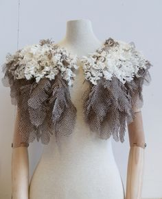 Hand-cut feather cape