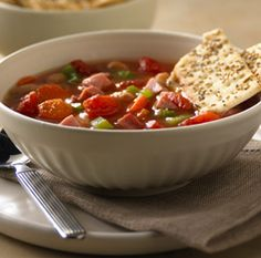 White Bean and Ham Soup: A simple white bean soup made with ham, carrots, celery and tomatoes White Bean Ham Soup, White Beans And Ham, Ham And Bean Soup, Easy Soup Recipes, Dinner Recipes, Cooking Recipes, Ham Recipes, Cookbook Recipes, Chili Recipes