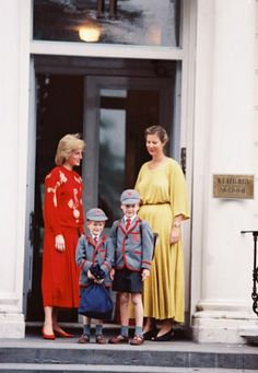 September 11, 1989: Princess Diana, Prince William and Prince Harry are welcomed by Headmistress Frederika Blair-Turner, on Harry's first day at Wetherby School. Princess Diana is wearing a red sweater with a print of some sort, and red culottes.