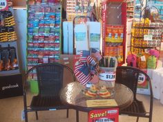 PT 49 JUNE 2015 FLAGS IN A STORE. IDAHO
