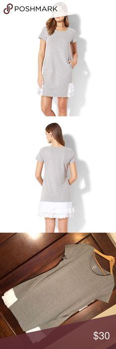 NWT T Shirt Dress with ruffles and pockets NWT T Shirt Dress with ruffles and pockets! Sizing runs a little big I am a 10-12 dress and the medium fits but the large is better if you want a looser casual look. Measures about 19 inches flat across arm pits and 33 inches long in the medium. Bundle with my other T-shirt dress for personal discount! New York & Company Dresses Mini