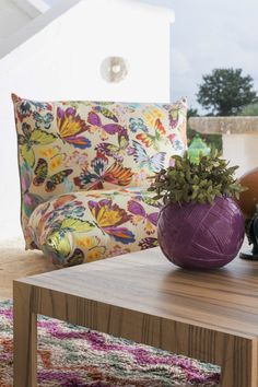 Colourful butterflies in pastel hues on a matt-shine micro checked satin to cover the modular sofa Living On The Edge, Modular Sofa, Wooden Tables, Outdoor Entertaining, Missoni, Bohemian Style, Butterflies, Armchair, Pastel