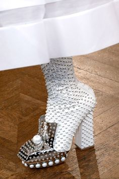 Boots that appear to be suffering from smallpox (Alexander McQueen 2014)