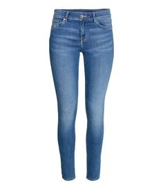 Denim blue. 5-pocket, low-rise jeans in washed superstretch denim with skinny legs.