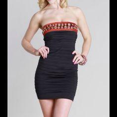 Niki Biki Black Strapless Dress Beautiful form fitting strapless tube dress with embroidered circle detailing at the neckline.  Back zipper.  92% Polyester 8% Spandex  Imported Niki Biki Dresses Strapless