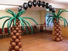 Balloon arch Palm tree balloon column . Cc , I'm picturing this up front with a waterfall be hind it???????