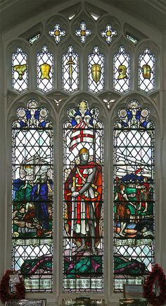 https://flic.kr/p/E38MqE   George, Rattlesden   Stained glass window in the parish church of St. Nichols, Rattlesden, Suffolk. The central figure of St. George is flanked by Abraham being prevented from sacrificing Isaac, and David slaying Goliath.