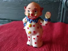 Vintage Waving Clown Shaker by Elvin.  Adorable clown that is waving to you! Bright happy clown has red dots all over his white suit with a blue ruffle around his neck and hands.  This fellow stands 4