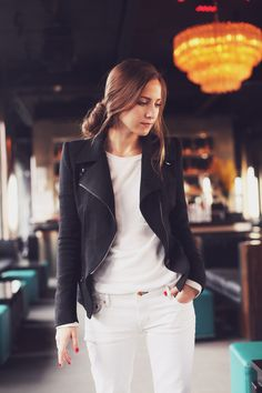 black leather jacket and white pants