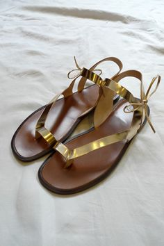 These gold sandals would be the worn by Miranda. Since she is on an island with sand, I would expect the shoes at that time to be flat with a gladiator style influence.