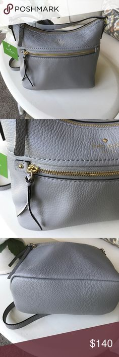 Kate spade gray Lelie handbag Cobble Hill collection. Gray crossbody bag. Zip top with one zip and two interior pockets. Measures 7.8 h x 8.4 w x 4.1 d. 22 inch strap drop. Gray color is perfect year round.  Super soft leather. Retail bag. Not outlet. kate spade Bags Crossbody Bags