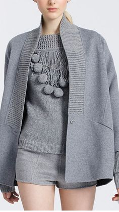 Pinned for the pom poms. Maybe with tassels instead and with the pieces of chain as is. May be it can be done with R cowl dress after remooving cowl. Knitwear Fashion, Grey Fashion, Crochet Fashion, Winter Fashion, Womens Fashion, Fashion Design, Fashion Trends, Techniques Couture, Look Chic