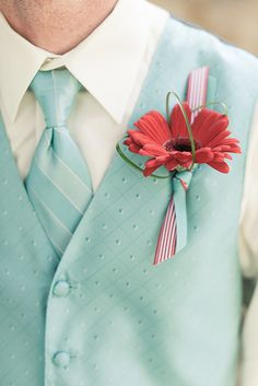 Red and aqua boutonniere for groomsmen.