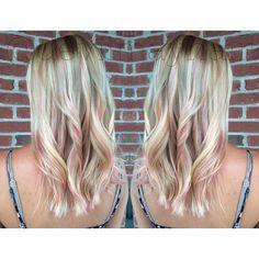 Soft pink peekaboo highlights on this pretty blonde.