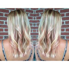 Soft pink peekaboo highlights on this pretty blonde.