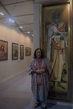 Artist Anjolie Ela Menon poses with her painting.