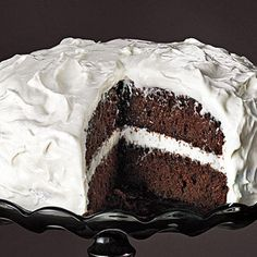 Learn how to make Chocolate Cake with Fluffy Frosting. MyRecipes has 70,000+ tested recipes and videos to help you be a better cook.