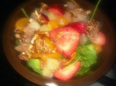 baby spinach w/ mandarin oranges, strawberries, pears & pecans. The oranges enhance the iron in the spinach for a super healthy snack.