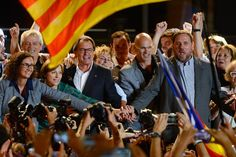 President of Catalonia Artur Mas (C) and President of Catalonia 'Esquerra Republicana de Catalunya' party (ERC) Oriol Junqueras (R) celebrate as he after the Catalanist coalition 'Junts pel Si' (Together for the Yes) claimed victory in the regional elections held in Catalonia on September 27, 2015 in Barcelona, Catalonia.