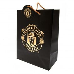 Large Manchester United gift bag with metal eyelets, made of card and featuring the club crest printed on the front. FREE DELIVERY on all of our football merchandise Manchester United Merchandise, Manchester United Gifts, Manchester United Football, Party Bag Toys, Party Bags, Football Birthday, Large Gift Bags, Sports Gifts, Party In A Box