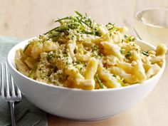 Get this all-star, easy-to-follow Food Network Triple-Cheese Spirals recipe from Food Network Kitchens.