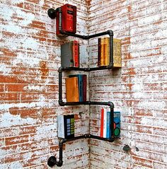 Tiny-Ass ApartmentVia Bored Panda.  Get into those corners! This cool, industrial pipe shelving is a great DIY that makes use of usually-wasted space.