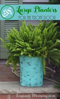 Looking for an easy, affordable way to add a little visual interest to your front door? Check out how I made these DIY Large Planters out of .. trash cans!