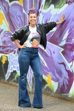 Flower girl: Alicia Keys looked in good spirits as she posed next to a wall of pretty flow...
