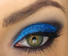 Glittery makeup can be fun and classy. Wear this eye look out to a party.