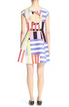 Perfect for spring, this multicolor and multidirectional striped dress is a true trendsetter. Sharp darting and pleats enhance the fit-and-flare silhouette while a bow-accented back cutout appeals to the playful nature.