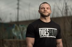 """Our CEO, Andy Frisella, made an incredible transPHormation last year in the MyTransPHormation contest. After every workout Andy would snap a photo of himself covered in sweat from killing his workout, with the tag line """"dues paid"""". Now you can too pay your dues at the gym with this new tee. This shirt has the same fit you have come to recognize from us, so no guessing needed on the size here. Click the pic above to get yours now!"""