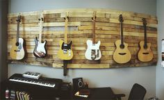 A really cool pallet wall for hanging/displaying awesomeness.