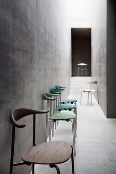 Concrete mood and earthy chair colours