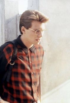 Christian Slater (1990) in a plaid shirt and glasses.
