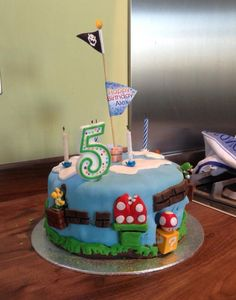 Another Mario Bros cake, this time a Mario World one. Inspiration from Pinterest. The Mario figurines on bricks that I'd bought online really helped!