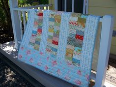 jelly roll: love the fabric used for the sashing and for the border
