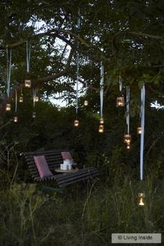 Candles hanging in the garden #mason jars