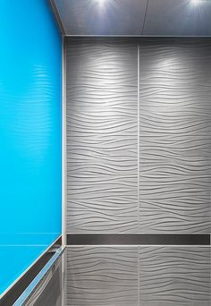LEVELe-106 Elevator Interiors with Capture panels in Bonded Aluminum with Natural Patina and Chardonnay pattern; ViviChrome Chromis glass with custom color interlayer; Fused Nickel Silver with Sandstone finish at Star TV India Headquarters, Mumbai, Maharashtra, India