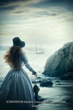 Trevillion Images - victorian-woman-at-the-shore-looking-out-to-sea