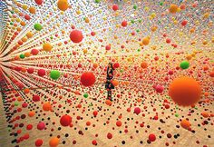 Atomic: Full of Love, Full of Wonder was a 2005 installation by artist Nike Savvas at the Australian Centre for Contemporary Art in Melbourne. The piece involved an immense array of suspended bouncy balls creating a dense field of color in the gallery space that was gently moved in waves by