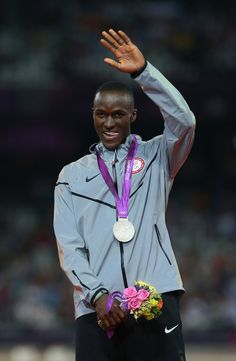 Silver medalist Will Claye of the United States celebrates on the podium during the medal ceremony for the Men's Triple Jump on Day 13 of the London 2012 Olympic Games at Olympic Stadium on August 9, 2012 in London, England.