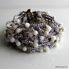 stitchesandpurls:  (viailoveetsy:Gray Silk Crocheted Cuff Wide and Thick with by WillOaksStudio)