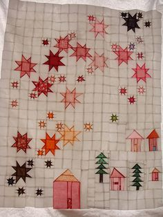 "I'm so madly in love with this quilt top by ""Future Arthritis?""! (I love any quilt top with light shining thru the back so you can see all the seams, but it was a great idea to combine the houses/trees with the stars!)"