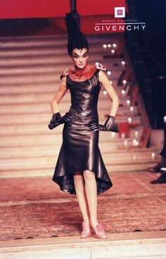 Dress of black leather; collar of red pheasant feathers and resin vulture skulls; gloves of black leather. Givenchy Haute Couture
