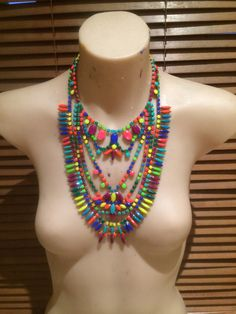 Ready to wear, ready to turn heads. She has been painted a warm palate with splashes of neon to give a show-stopping viabrant look.  #statementnecklace #bibnecklace #neonnecklace