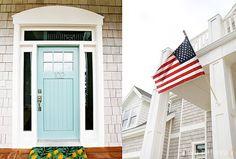 Light gray paint, white shutters, powder blue door