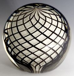 """Paperweight - White core surrounded by black cased lattice. Maker unknown, English? 3""""w x 2 7/8""""t, 20.4 oz. - #0598"""