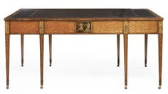 A George III pen-engraved inlaid satinwood and harewood library table in the manner of Christopher Fuhrlohg circa 1780 height 30 1/2 in.; width 5 ft. 6 in.; depth 42 in. 77.5 cm; 167.6 cm; 106.7 cm