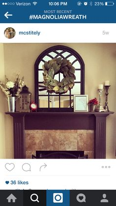 Fireplace mantle with mirror and wreath
